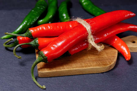 red and green hot chili pepper in a rustic style. Vintage style. selective focus Imagens