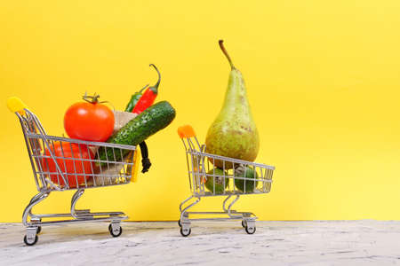 Vegetables and fruits in the shopping cart order products online Healthy food. copyspace