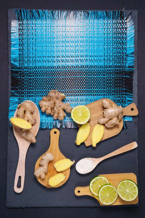 Citrus, ginger, honey, dried fruits. foods with vitamin C. Disease prevention. black background. Flat lay copy space