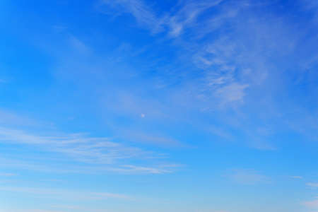Air clouds in the blue sky.Blue backdrop in the air. Abstract style for text.