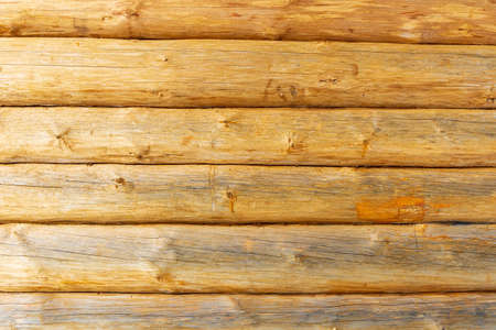 wooden background texture of wall of log rural house with copy space for your design.