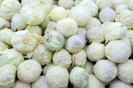 Cabbages display on sale in market. Vegetables markets. Cabbage background. Fresh cabbage from farm field. Vegetarian food concept.