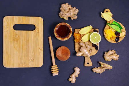 Citrus, ginger, honey, dried fruits. foods with vitamin C. Disease prevention. black background. Flat lay. copy space