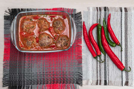 Baked meatballs on pan hot right out of the oven. food preparation. chili peppers