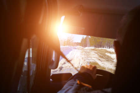 Driving a car in the first person. driving on a winter ice road. selective focus Archivio Fotografico