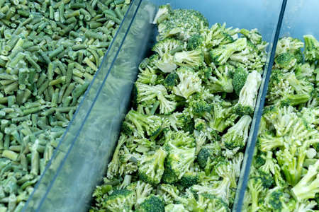 frozen broccoli in the background. sale of vegetables in the supermarket. selective focus Archivio Fotografico