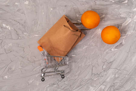 Shopping cart brown craft paper package with handles, food delivery, sale, consumerism and advertising concept.