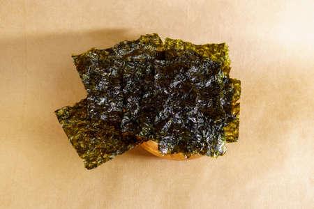 Japanese food nori dry seaweed or edible seaweed close-up.