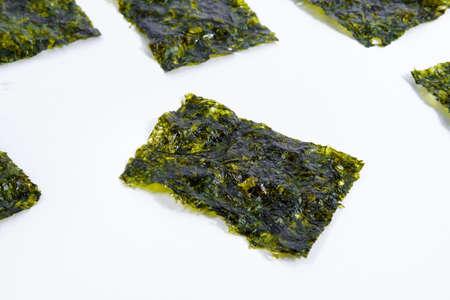 Nori chips dry Japanese organic seaweed on a white background. Stok Fotoğraf