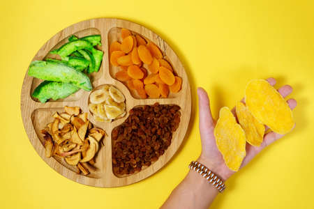 Mixture of dried fruits. Symbols of the Jewish holiday Tu Bishvat. Thanksgiving Day. Flat lay, top view