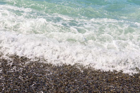 stormy sea waves. Crashing wave line in sea with foam white texture.