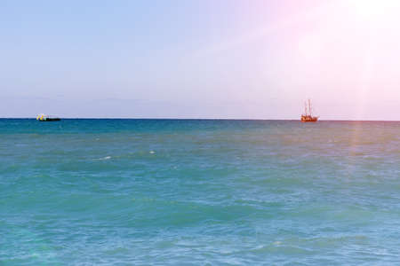 Sea view, sailboats far away in the sea in sunny day, natural background. Stok Fotoğraf