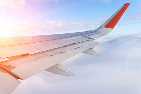 plane flying above the clouds. The concept of fast travel Stok Fotoğraf