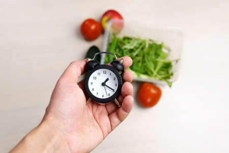 clock in restaurant, abstract background.for time for diet concept. Stok Fotoğraf