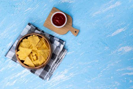 Tortilla nachos corn chips sauce. Flat lay, copy space