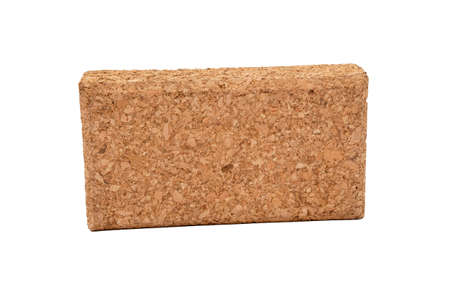 one yoga block made of cork, on a white background, isolate, selective focus