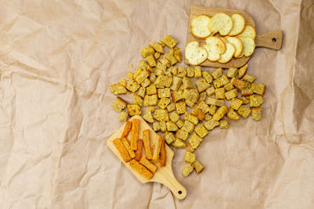 croutons, made of different bread, light and brown, with space for copying text. flat lay
