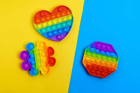 Rainbow anti stress toy fidget push silicone toy antistress pop it. Multi colored background Stok Fotoğraf