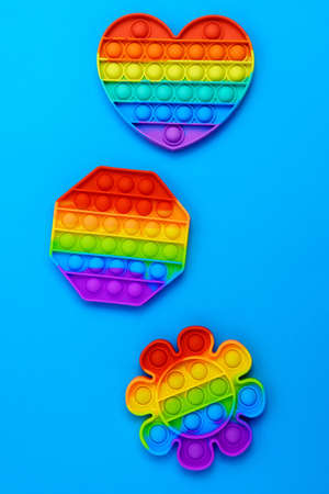 Toy pop it. Rainbow color. Antistress toy for children and adult. Top view. Vertical photo