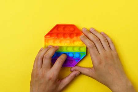 Rainbow anti stress toy fidget. Silicone toy antistress pop it. Stok Fotoğraf