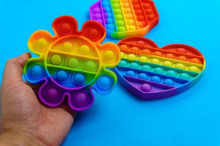 Pop it toy silicone sensory anti stress fidget toy colorful rainbow game. Trendy push bubble toys Stok Fotoğraf