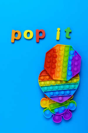Toy pop it. Poppit is a new fidget toy, popular among children and people with special needs. On a blue background