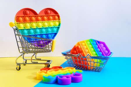 Rainbow anti stress toy fidget. Silicone toy antistress pop it. Copy space