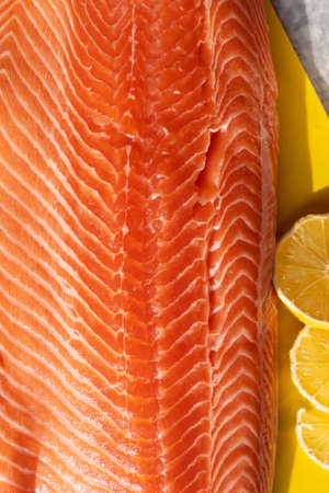 Close-up preparing a fillet of red salmon fish on the table. Selective focus
