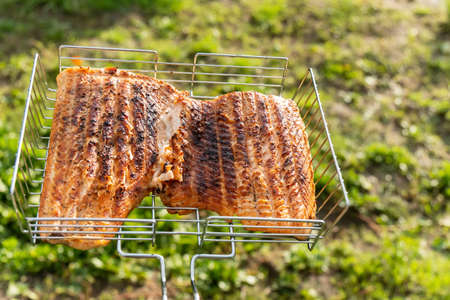 Salmon or trout red fish fillet on grill. Seafood steak filet roast for dinner on charcoal. Selective focus