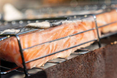 Grilled salmon fish close-up on a flaming grill. Selective focus Banque d'images