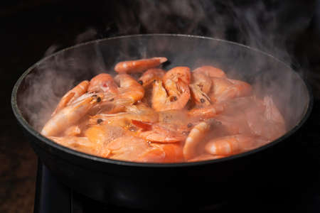 Fried shrimp in a frying pan. Healthy Seafood, Seafood, Shrimp Cooking Close-up. Asian cuisine. Slow moti