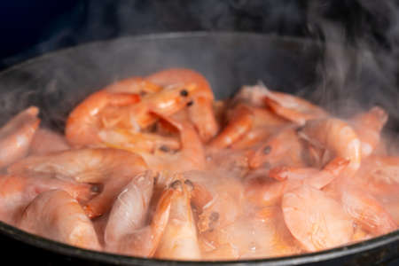 Close up of shrimps in frying pan. Close up of cooked prawns. Macro food background. Seafood