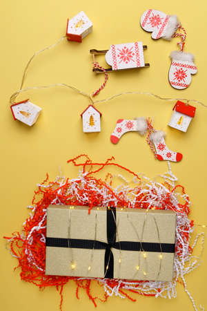 Christmas gift boxes. Happy New Year, Merry Christmas. Winter holiday theme. yellow background. Flat lay