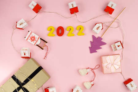 Christmas gift boxes Happy Christmas. Winter holiday theme. Happy New Year. Pink background. Flat lay