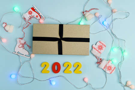 Christmas gift box for the New Year 2022 Christmas holiday on a blue pastel background.