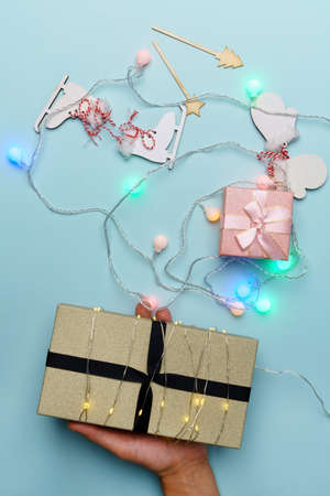 Christmas ornaments and gift boxes. Flat lay, top view. Christmas background. Vertical photo