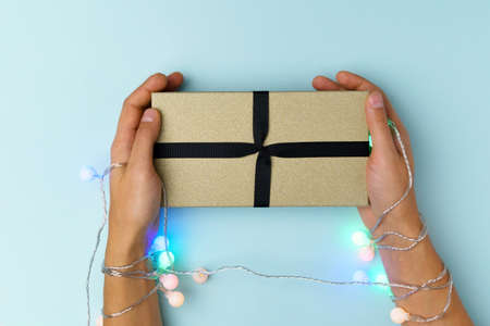 Christmas gift box for the New Year Christmas holiday on a blue pastel background. Copy Space