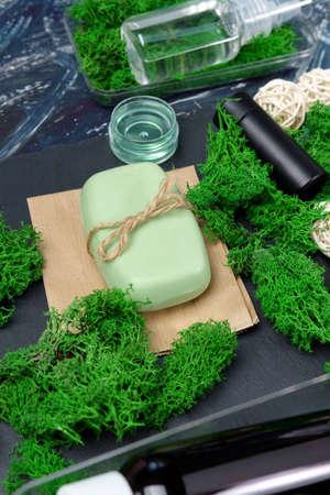 Cosmetic and moss, Skin care, organic body treatment, spa concept. Biophilia design. Organic cosmetics. Vertical photo