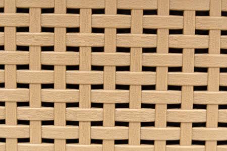 Plastic brown lattice basket close-up macro. Background, texture Banque d'images