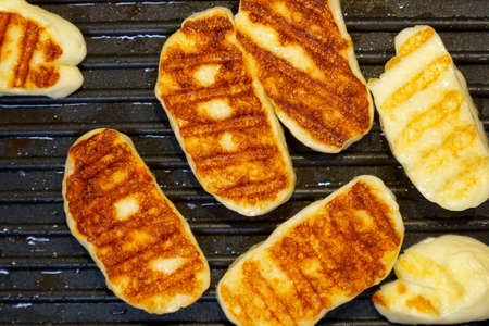Cyprus halloumi cheese. Cheese toasted, cooking grilled cheese on a grill pan Banque d'images