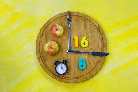 Intermittent Fasting 16:8. Popular health and fitness trend. Flat lay. Healthy eating, weight loss