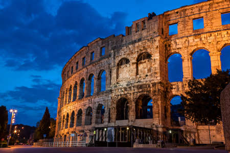 Pula amphitheatre during the morning blue hour from the outside Stock Photo