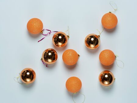 Christmas balls of different colors lie on a white background. The concept of Christmas, new year