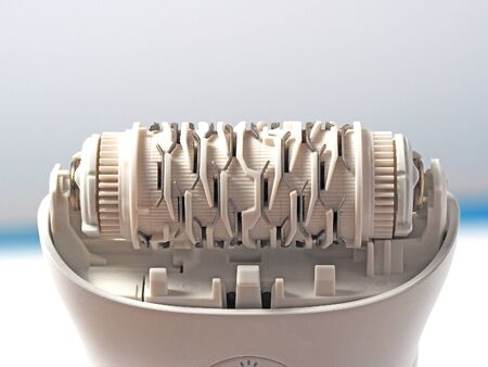 electric epilator close-up. A tool for removing hair and maintaining beauty and smoothness. Standard-Bild
