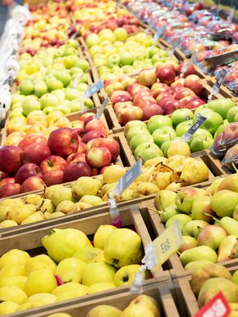 A variety of colorful fruits are on display in the supermarket. Pears, apples. Stock fotó