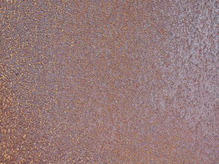 An old metal wall covered with rust. Seamless background