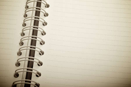 Opened spiral notebook with copy space area