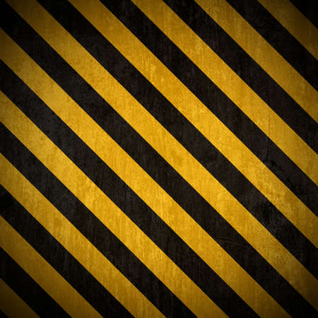hazard: Traditional black and yellow warning background with grunge effect