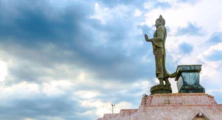 venerable: Buddha statue on blue sky in khonkaen ,thailand Stock Photo