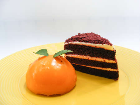 dish disk: Orange cake and Chocolate layer cake on Yellow plate